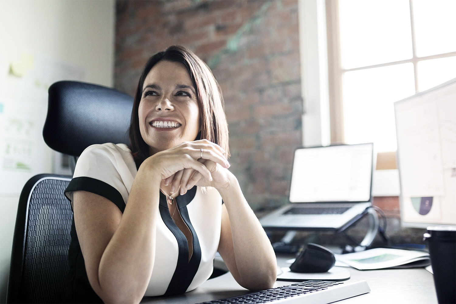Smiling businesswoman at office desk