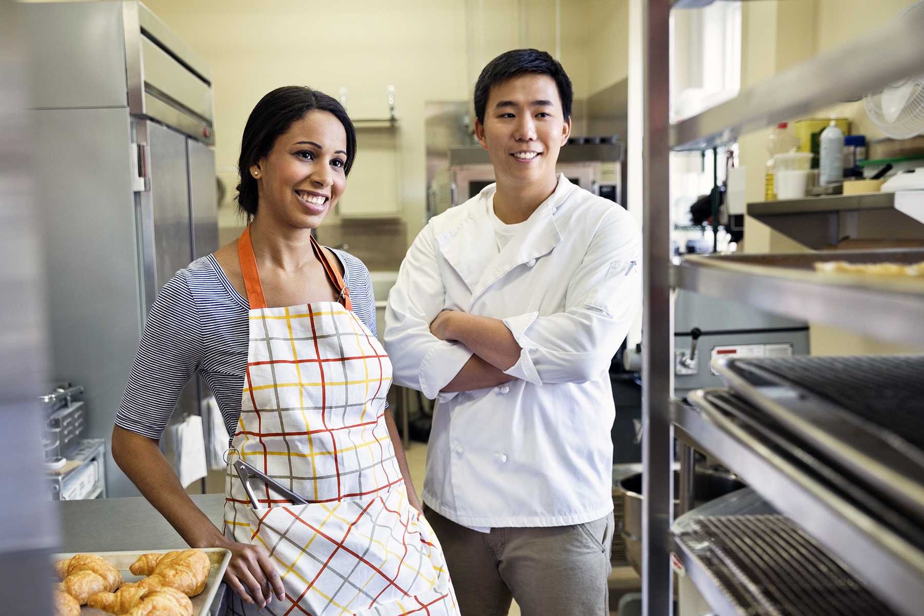 Smiling bakers standing in bakery