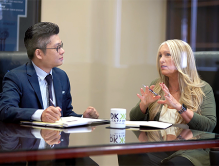 DKKD Staffing CEO Diane Krehbiel-Delson speaking to a Cathay Bank banker in a business meeting
