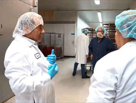 Beef Jerky Factory CEO Waleed Saab speaking with his employees at the company's factory.
